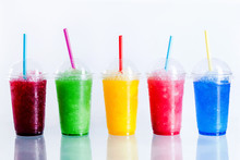 Row Of Frozen Fruit Slushies In Plastic Cups