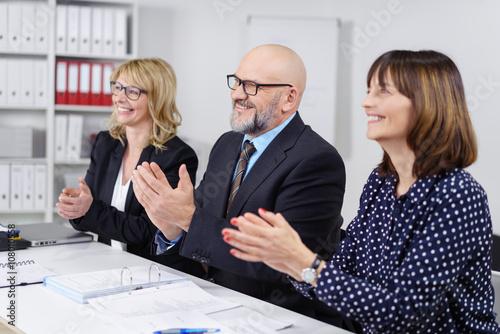 Fotografie, Obraz  geschäftsleute applaudieren während eines vortrags