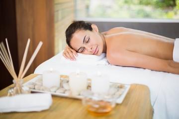 Obraz na płótnie Canvas Woman lying on massage table at spa