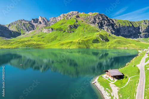 Foto op Aluminium Heuvel View to Melchsee Frutt and Swiss Alps panorama from Melchsee Frutt, Switzerland, Europe