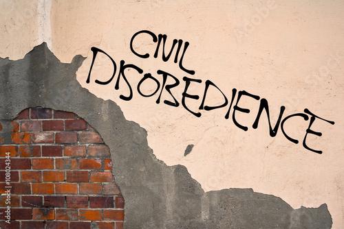 Foto op Aluminium Graffiti Handwritten graffiti Civil Disobedience sprayed on the wall, anarchist aesthetics