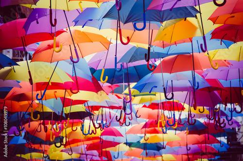 фотографія  Colorful umbrellas hanging above the street