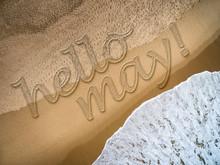 Hello May Written On The Beach