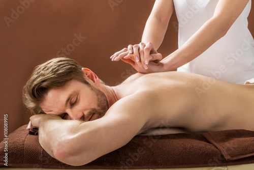 Young Man Receiving Back Massage At Spa Wallpaper Mural