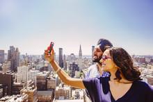 Indian Couple Taking Selfie Ov...