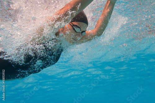 Butterfly style swimming, underwater view Wallpaper Mural