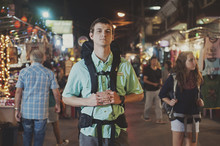 Caucasian Tourist Standing In Market At Night