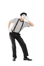 Male Mime Artist Trying To Hear Something