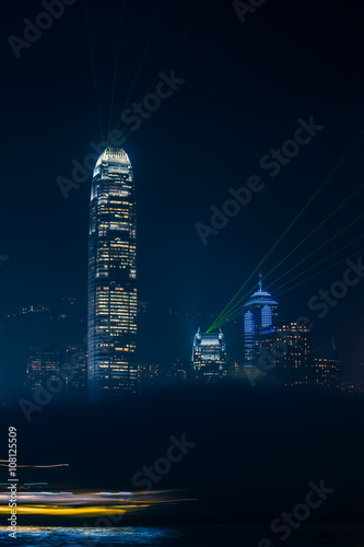 Photo  Hong Kong Night View / Illuminated city skyline detail at night with foggy cloud