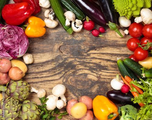 Fotobehang Fresh vegetables on wooden background.