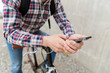 hipster man in earphones with smartphone and bike