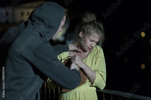 Fotografie, Obraz  Criminal strangling woman