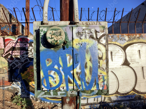 Photo  Urban ghetto electrical box with colorful painted graffiti - landscape color pho