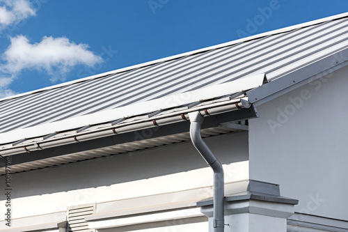 Fotografia, Obraz  gray metal roof with gutter and drainpipe