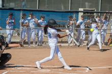 Filipino Softball Batter Hitting A Line Drive.
