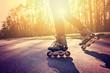 Leinwanddruck Bild - Teenage girl on roller skates at summer.