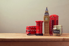 Travel To Great Britain Concept With Souvenirs And Money Box Jar. Planning Summer Vacation, Money Budget Trip Concept.