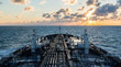 canvas print picture - Sunset seascape with tanker deck