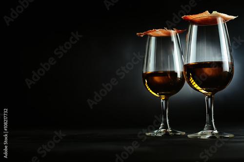 Elegant Spanish tapas on sherry glasses