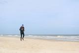 Senior man running at beach