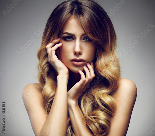 Fényképezés  Beautiful blonde woman with long, healthy , straight and shiny hair