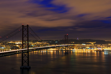 Fototapeta Panorama Miasta Night view of Lisbon and 25th of April Bridge, Portugal