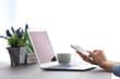 Woman's hands with laptop and mobile phone at the table