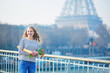 Girl with traditional French baguette and tulips