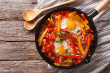 Traditional Basque Piperade With Eggs Close-up. Horizontal Top View