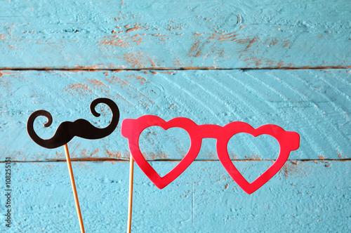Fotografija  paper heart shape fake glasses and mustaches in sticks