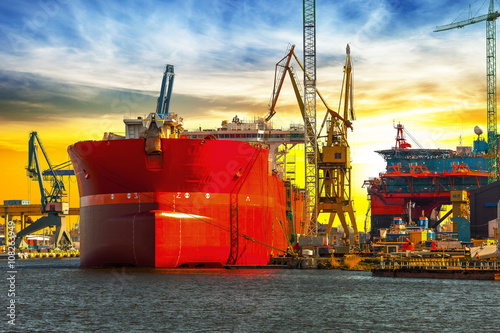 Fototapeta View of the quay shipyard at sunrise in Gdansk, Poland.