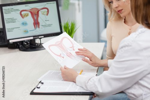 Vászonkép Beautiful blond girl is consulting a doctor