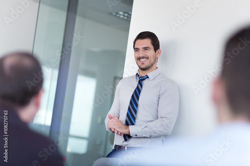 Fototapety, obrazy: Relaxed cheerful team leader and business owner leading informal in-house business meeting. Business and entrepreneurship concept.