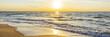 canvas print picture - Urlaub am Meer - Sandstrand und Sonnenaufgang an der Ostseeküste - Banner / Panoroma
