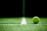 Fototapeta sport - soft focus of tennis ball on tennis grass court