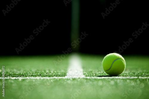 Fotografie, Obraz soft focus of tennis ball on tennis grass court