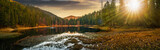 Fototapeta Na ścianę - panorama of crystal clear lake near the pine forest in  mountains at sunset
