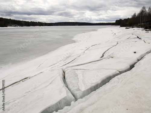 ice drift on the river in early spring on a cloudy day #108299515