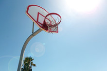 Outdoors Basketball Hoop At Beach With Bright Sun Flare