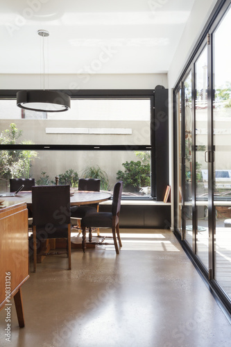 Modern Dining Room With Concrete Floor And Glass Bi Fold Doors