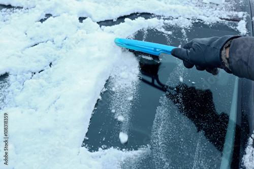 Printed kitchen splashbacks Fishing Removing snow from car windshield, closeup