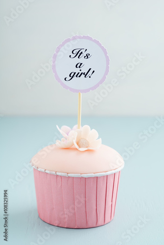 Photo  Baby shower cupcake for a girl with fondant and sugar flowers