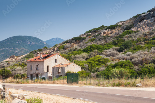 Abandoned house near a highway, Corsica - Buy this stock