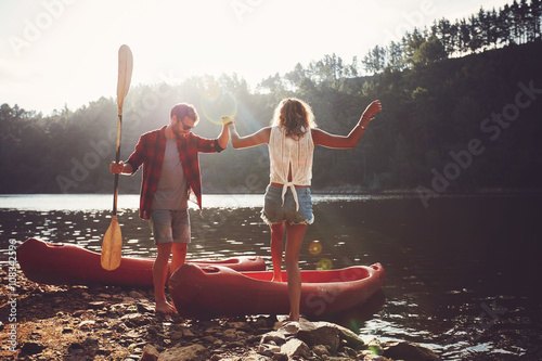 Fotografie, Obraz  Couple going for a canoe ride in the lake.