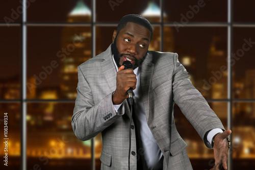 Fotografie, Obraz  Expressive black man with microphone