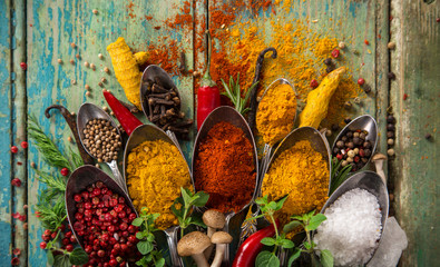 FototapetaVarious colorful spices on wooden table