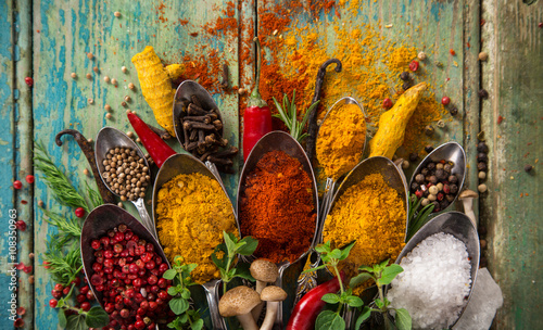 Various colorful spices on wooden table Tapéta, Fotótapéta