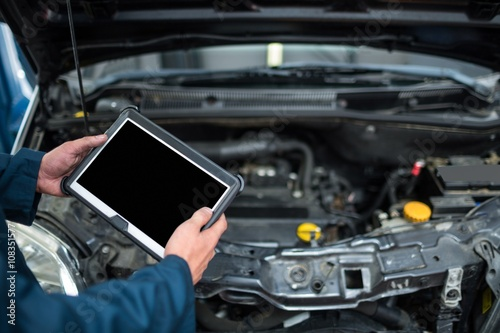 Mechanic holding diagnostic tool