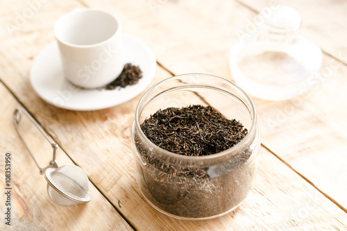Wall Murals Coffee beans Tea set on the wooden table at sunny morning