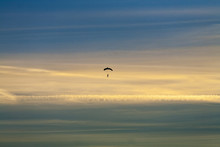 Silhouette Of Lone Skydiver Fa...
